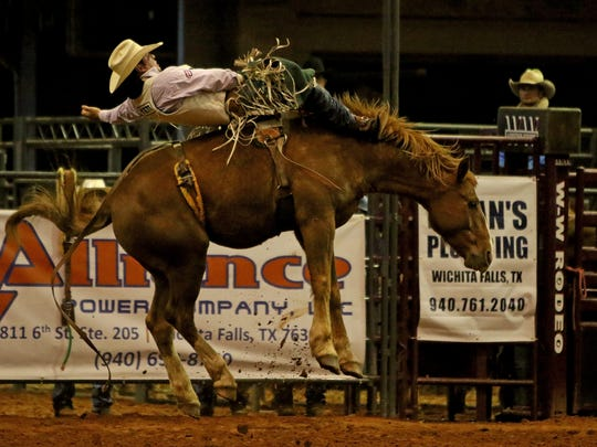 Richmond Champion competes in bareback riding during the second round of the PRCA Rodeo Saturday, April 21, 2018, at Kay Yeager Coliseum in Wichita Falls.