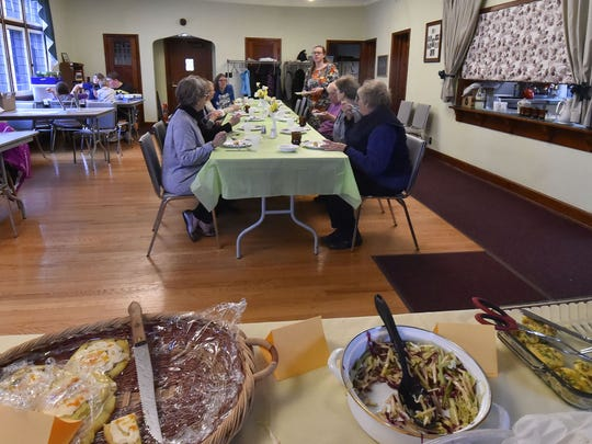 Let's Get Cooking cookbook club coordinator Katie Haasch talks with members of the group during their April 12 meeting at St. Agnes-by-the-Lake Episcopal Church in Algoma.