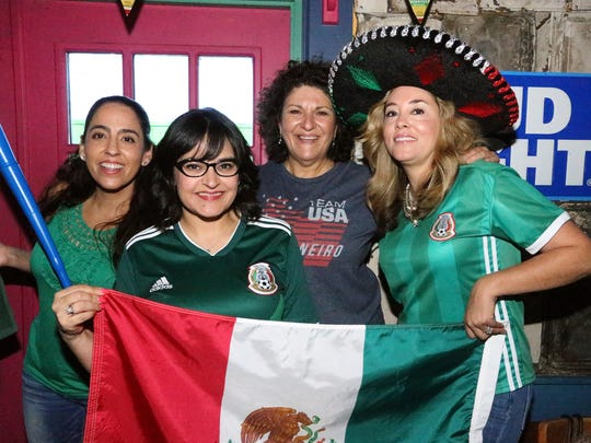 Berenice Zubia, left, with other Mexico soccer fans