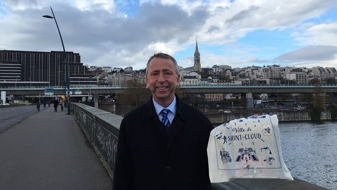 St. Cloud Mayor Dave Kleis stands on a bridge crossing the Seine River during his trip to France in early December. Behind Kleis is Saint-Cloud, France, which St. Cloud, Minnesota was named after.