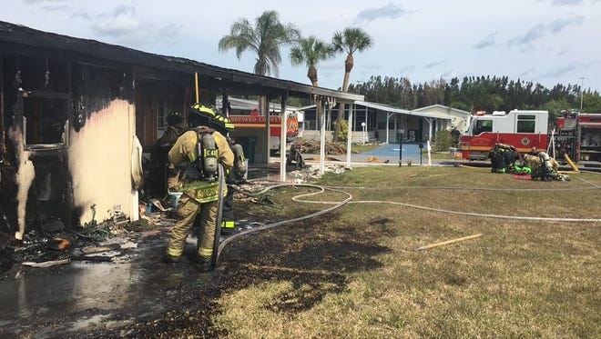 Firefighters put out a fire in Barefoot Bay Tuesday.