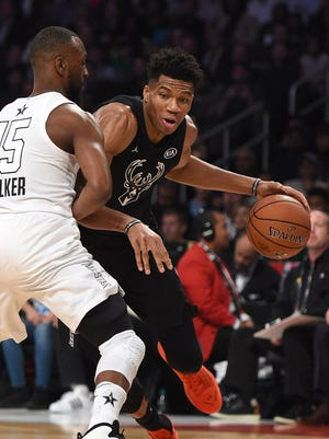 Giannis Antetokounmpo drives against Kemba Walker during Sunday's NBA All-Star Game in Los Angeles.