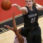 Ursuline center Maddie Stuhlreyer blocks a shot by Princeton guard Malika Wildon, Jan. 19. Ursuline is a team to watch in the postseason.