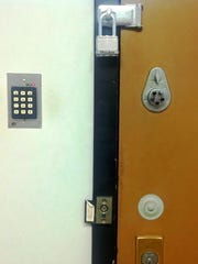 The door to the drug evidence storage room at the Delaware Chief Medical Examiner's Office in Wilmington is shown on Feb. 20, 2014. State Police placed a padlock on the door after evidence thefts and tampering were discovered.