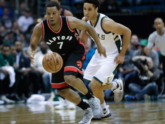 Toronto Raptors' Kyle Lowry steals the ball from Milwaukee Bucks' Malcolm Brogdon during the first half of Game 4 of an NBA first-round playoff series basketball game Saturday, April 22, 2017, in Milwaukee. (AP Photo/Morry Gash)