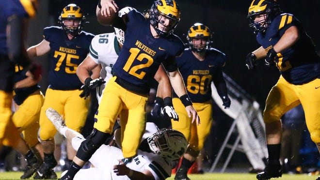 Prince Avenue's Brock Vandagriff (12) rushes for a touchdown during Friday night's 41-7 win over Athens Academy.