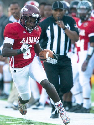 Kerryon Johnson of Madison Academy runs downfield during the Alabama-Mississippi All Star Game at Cramton Bowl in Montgomery, Ala., on Saturday, Dec. 13, 2014.
