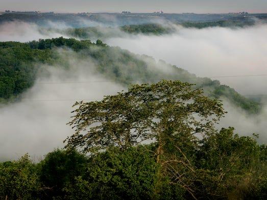 When the sun rises, an early morning mist follows the