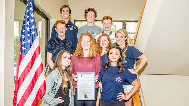 Mayor Todd Wodraska of The Town of Jupiter has proclaimed April 20 as Social and Emotional Health Awareness Day to coincide with Generation Stand UP's #Glow2Know Dance-a-Thon and community health awareness event at Harbourside Place,  in Jupiter. Pictured are Stand UP Foundation teens with the proclamation on March 14 at Jupiter Town Hall.