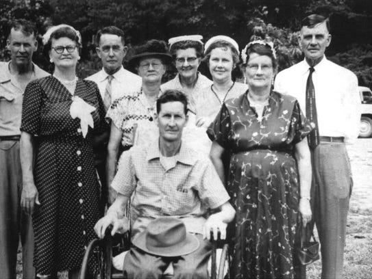 William Kelly Shope, far right, stands with his siblings