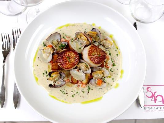 Eight4Nine Restaurant & Lounge food Shoot Dungeness Crab-stuffed Piquillo Pepper, Saffron Aioli, Greens