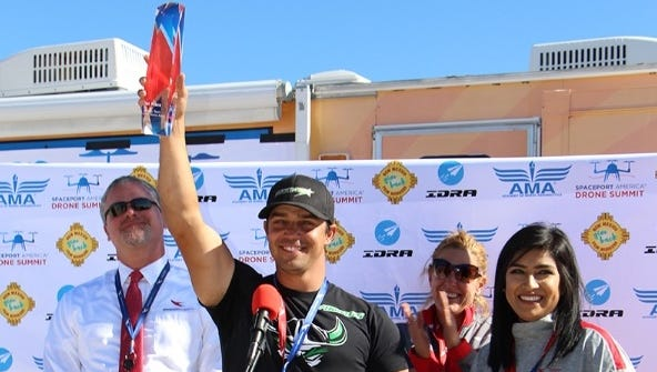 Shaun Taylor of Albuquerque, current world-champion drone racer, holds an individual drone-racing competition trophy on Sunday at Spaceport America, located in southeastern Sierra County. Taylor participated in the facility's first-ever Spaceport America Drone Sumit, which included two categories of drone races.
