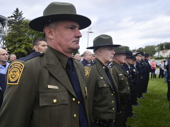 U.S. Customs and Border Protection agents stand at