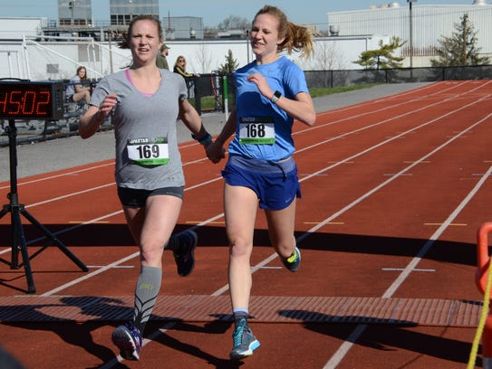 The 24-year-old McMaster twins finish hand in hand