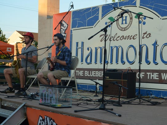 Tucker Hill performs at the beer and wine garden during