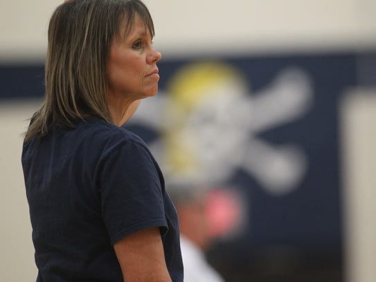 Former five-time state champion Sneads volleyball coach