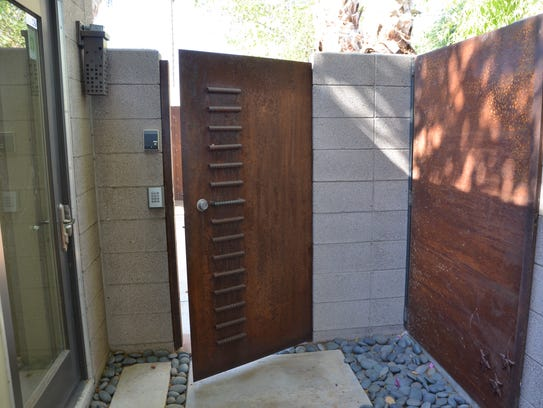 The home is accented over and over with rusted steel,