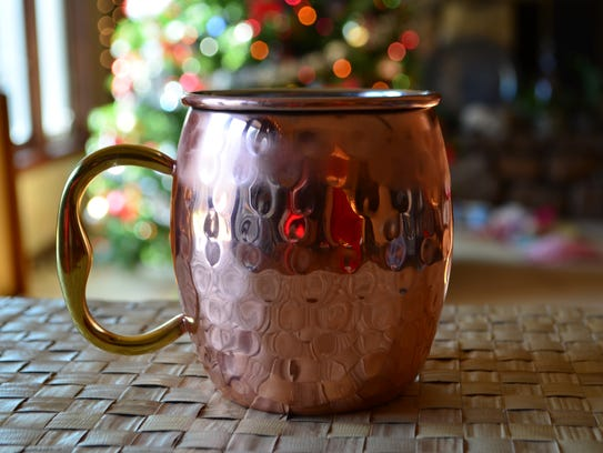 Enjoy this Cranberry Moscow Mule in front of the Christmas