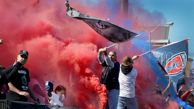 The Brickyard Battalion celebrates a goal by Indy Eleven forward Justin Braun in the second half of their NASL soccer match against Puerto Rico FC Saturday, April 1, 2017, afternoon at Carroll Stadium on the campus of IUPUI.