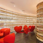 The Next Whisky Bar has a wall of custom whisky bottles featuring labels stamped out of metal.