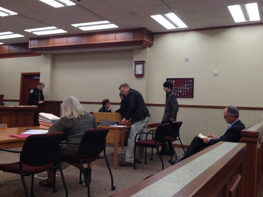 Kory Murphy of Sturgeon Bay, preparing to sit with defense attorney Brett Reetz, appeared in Door County Circuit Court II Monday. Murphy faces two felony counts of possessing child pornography.
