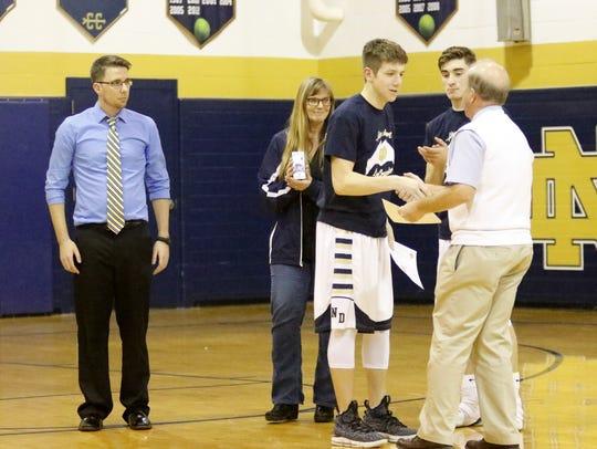 Notre Dame boys basketball coach Bill Hopkins presents