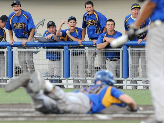 New Berlin West's dugout reacts to Darrin Sowinski scoring a run in the seventh inning against Kettle Moraine in the state semifinals.