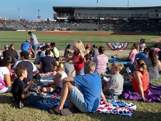 Fans fill the berm behind left field beofre the game