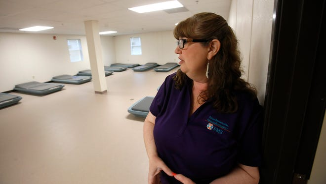 Sobering Center administrative director Kristine Carlson leads a tour of the new facility on Friday.