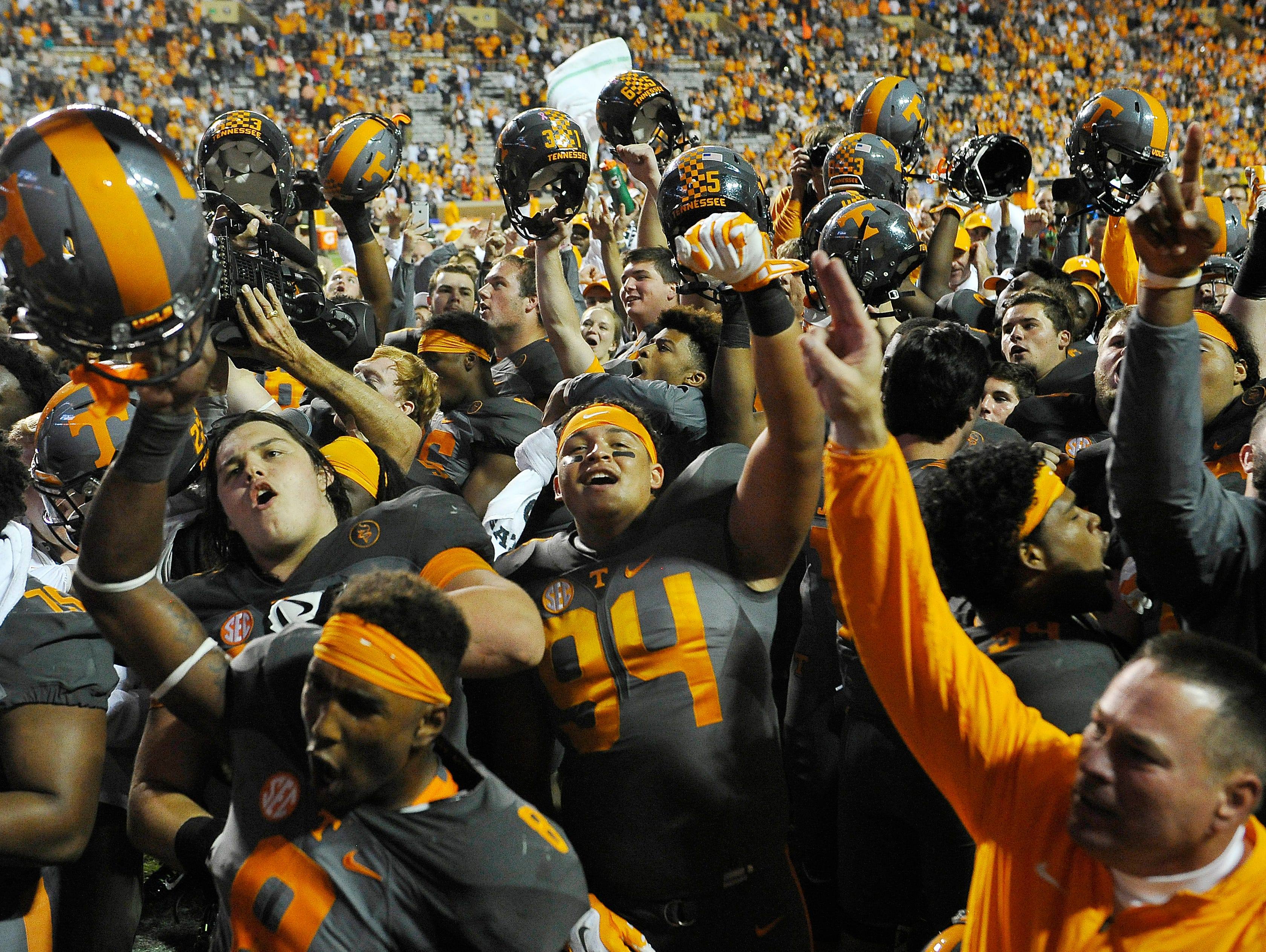 Coach Butch Jones and his team celebrate their 38-31 victory over Georgia on Oct. 10, 2015.