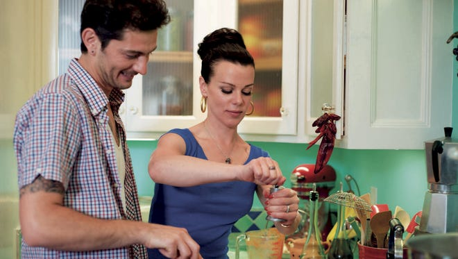 "Actress Debi Mazar and her husband Gabriele Corcos host the Cooking Channel TV show ""Extra Virgin."" Mazar is 50."