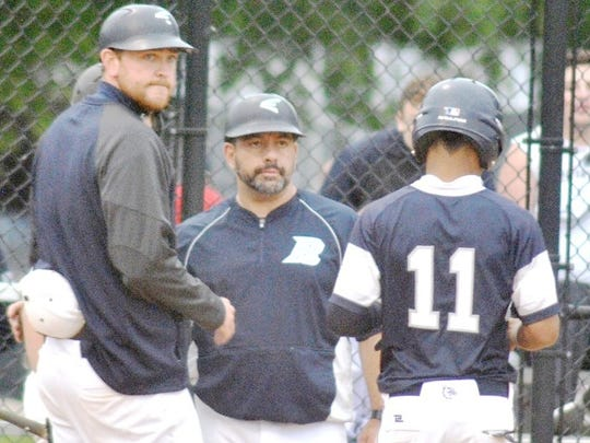 Rutherford baseball coach Carmen Spina (center) won his 200th career game when his team defeated Eastern Christian, 10-0.
