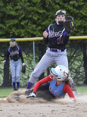 Kewaunee's Kassi Smidel forces the out at second base against Kendra Dantoin of Southern Door during WIAA Division 3 sectional semifinal game Tuesday at Southern Door.