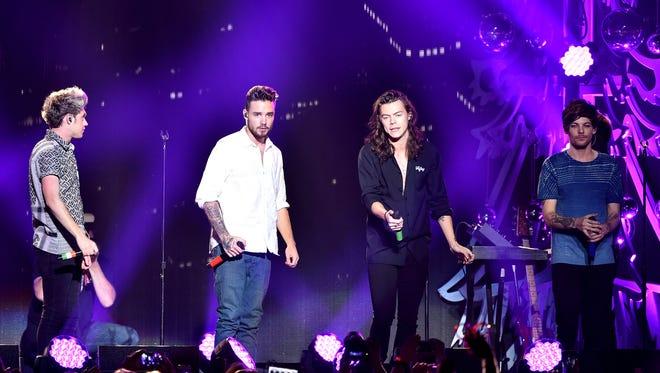 (L-R) Singers Niall Horan, Liam Payne, Harry Styles and Louis Tomlinson of One Direction perform onstage during 102.7 KIIS FM's Jingle Ball 2015 Presented by Capital One at STAPLES CENTER on December 4, 2015 in Los Angeles, California.