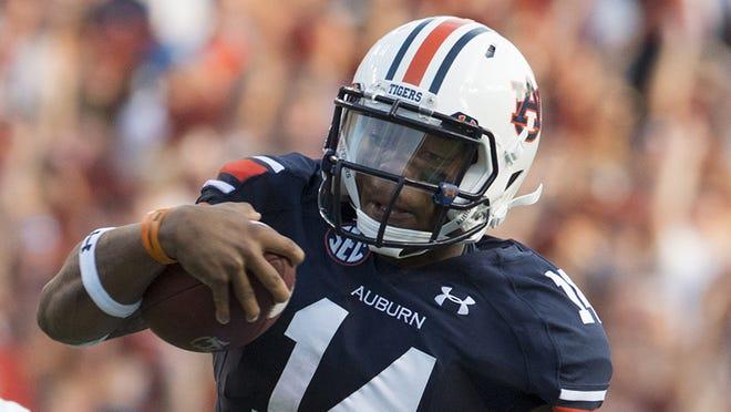 Auburn quarterback Nick Marshall takes on what what nearly his Kansas State team tonight.