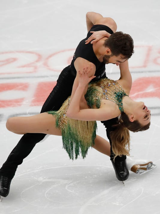 FILE - In this Friday, Jan. 19, 2018, file photo, Gabriella Papadakis and Guillaume Cizeron of France perform their short program in the ice dance event at the European figure skating championships in Moscow, Russia. The French ice-dance pair are breaking records as they prepare to challenge for Olympic gold next month. (AP Photo/Pavel Golovkin, File)