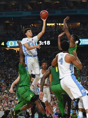 North Carolina Tar Heels forward Justin Jackson (44) lays the ball up between Oregon Ducks guard Dylan Ennis (31) and Kavell Bigby-Williams (35) in the semifinals of the 2017 NCAA Men's Final Four at University of Phoenix Stadium.