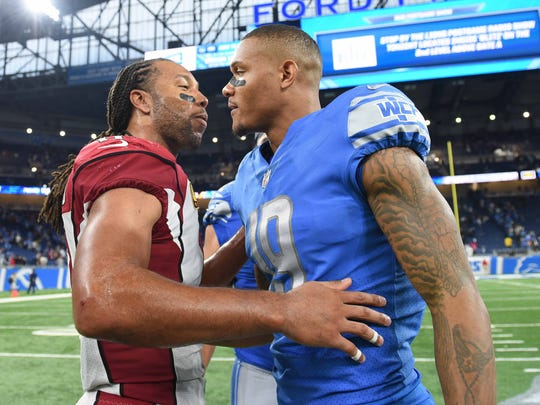 Cardinals receiver Larry Fitzgerald and Lions receiver Kenny Golladay meet after the Lions' 35-23 win at Ford Field on Sunday, Sept. 10, 2017. In his NFL debut, Golladay scored two touchdowns in the fourth quarter.
