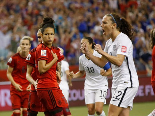 US midfielder and former Ben Davis star Lauren Holiday reacts after a missed German PK in the semifinals.