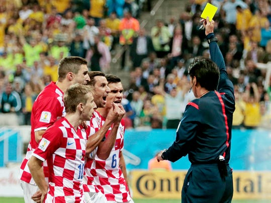 Croatia players argue after being given a penalty by referee Yuichi Nishimura from Japan during the group A World Cup soccer match between Brazil and Croatia, the opening game of the tournament, in the Itaquerao Stadium in Sao Paulo, Brazil, Thursday, June 12, 2014.  (AP Photo/Ivan Sekretarev)