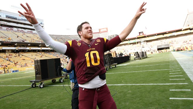 Arizona State quarterback #10 Taylor Kelly says farewell to the Sun Devil fans after beating Washington State during his final home game of his college career on Saturday, Nov. 22, 2014 at Sun Devil Stadium in Tempe, AZ.