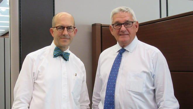 Park National Bank CEO David Trautman, left, and former CEO Dan DeLawder.