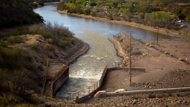 Water pours into the Rio Grande from the Caballo Dam Saturday, March 26, 2016.