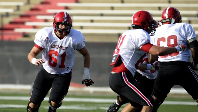 Sophomore Grant Horst (61) has grown into a starting position on the UL offensive line. Paul Kieu, the Advertiser  UL center Grant Horst (61) runs a blocking assignment during a scrimmage at Cajun Field in August. UL center Grant Horst (61) runs a blocking assignment during a scrimmage at Cajun Field in Lafayette, La., Saturday, Aug. 9, 2014. Paul Kieu, the Advertiser