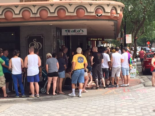Hundreds wait in line for tattoos commemorating the