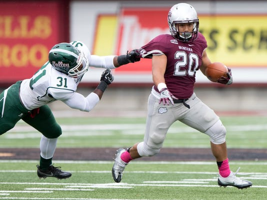Montana running back John Nguyen (20) breaks away from a tackle by Mississippi Valley State linebacker Jordan Freeman (31) in the first half of an NCAA college football game Saturday, Oct. 8, 2016, in Missoula, Mont. (AP Photo/Patrick Record)