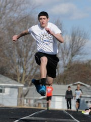 Sartell's Jake Lieberg practices the triple jump Friday