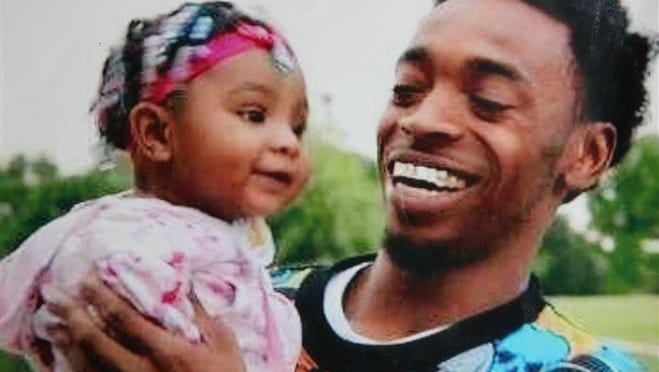Derek Williams is shown with one of his daughters in this family photo.