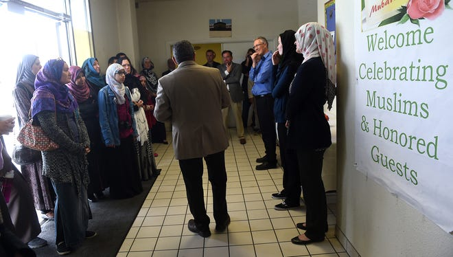 Sherif Elfass, middle, answers questions during an RGJ Know Your City tour of the Northern Nevada Muslim Community Center in Sparks in April.
