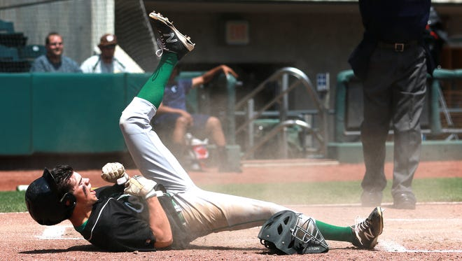 Thomas Staab celebrates after sliding safely into home plate, scoring the first run of the game. Clear Fork took on Waynedale in the Division II state semifinals, but lost 6-3.